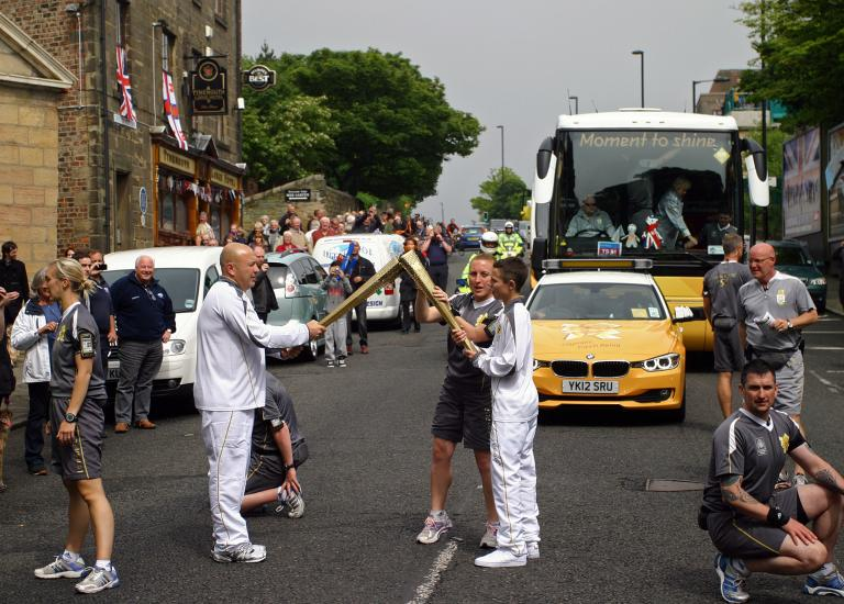 The Olympic torch passing the Lodge in June 2012